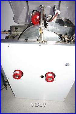 Chocolate enrober with bottoming unit and cold plate table coating