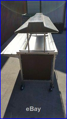 Salad bar stainless steel 2-7 plate holders (used) non refrigerated withcastors